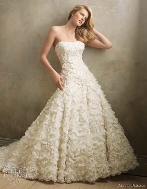 This dress is flowy, strapless, and has great texture that will leave the crowd in awe.