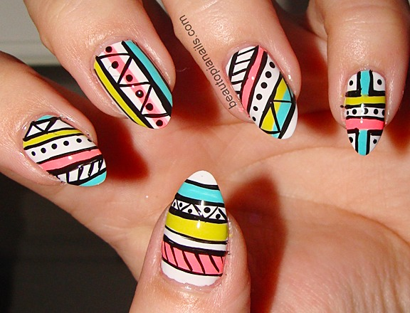 Aztec, stiletto nails! Cute for summer💛