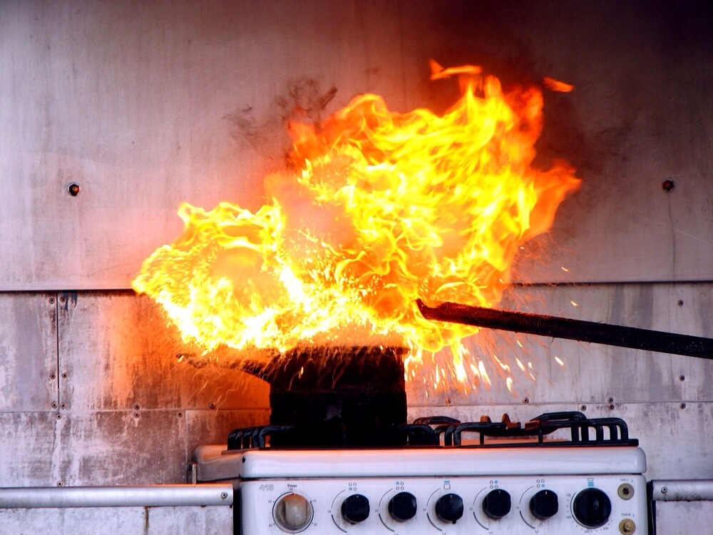 Extinguish grease fires. Keep a box of salt near your stove and oven, and if a grease fire flares up, douse the flames with salt. (Never use water on grease fires; it will splatter the burning grease.)