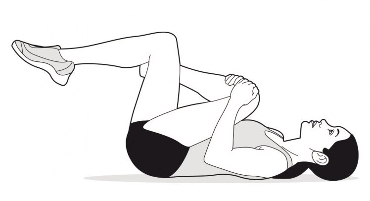 LYING GLUTE STRETCH: Lie on your back with your knees bent and your feet flat on the floor. Cross the calf of one leg over the thigh of the other, and grasp the back of that thigh with both hands.