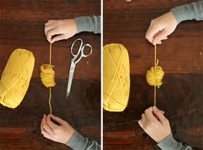Cut the yarn after 90 wraps, and carefully slide it off your fingers. Lay it down over the 8-10 inch piece of yarn. Tightly tie a knot around the middle of the 90 loops.