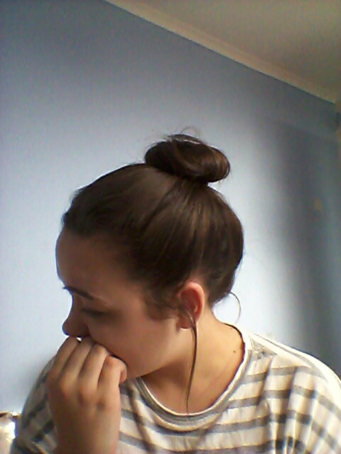 Scoop all of your hair into a high bun.  Loosen a few pieces of hair to add volume and soften the look.