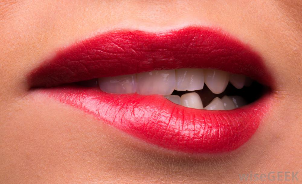 After applying your lipstick, dab a bit of sugar on them, wait 5 mins, then gently brush off