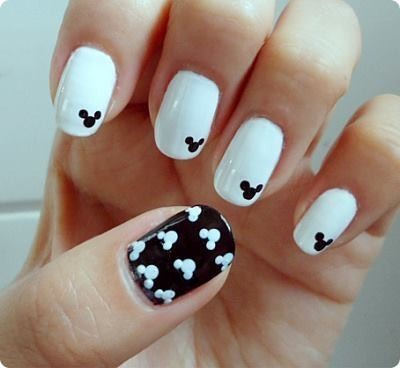 Start off with painting your nails a color and then get a bobby pin and dab three little dots in the shape of Mickey Mouse