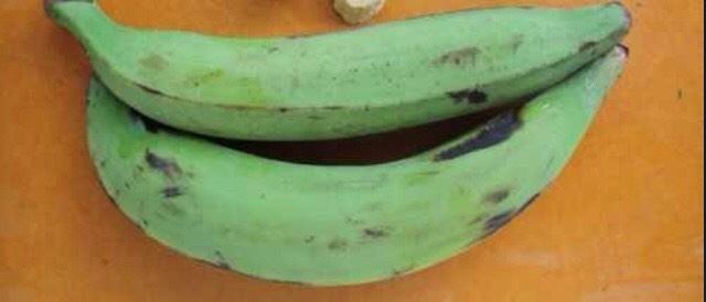 Get a couple of platanos aka plantains. Cut each end off and peel.