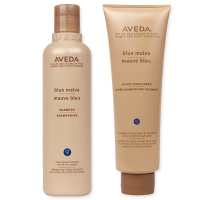 Use Aveda Blue Malva shampoo & conditioner to tone unnatural orange/yellows in dyed blonde hair. The subtle blue toner works to neutralize brassy blonde color and obtain a much cooler and natural color. Use the conditioner twice a week alternating between your regular one. I swear by these products!