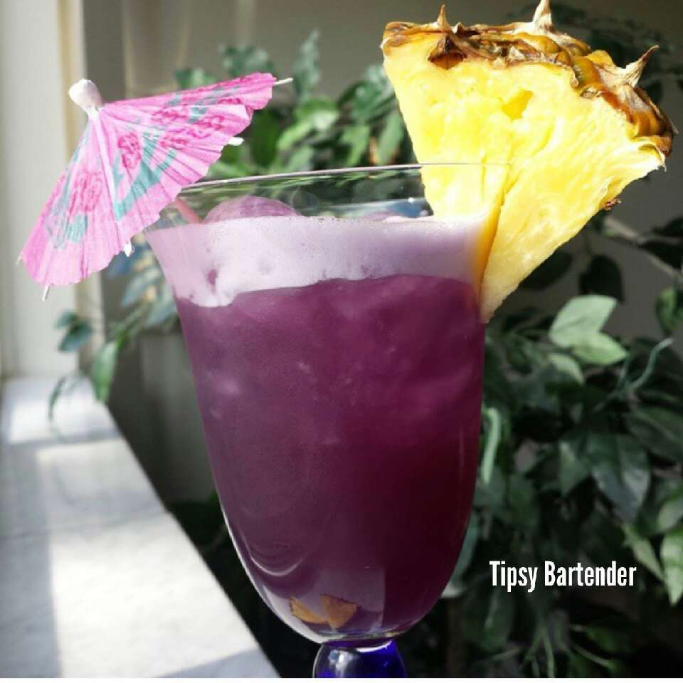 1oz Vodka 1/2 Pineapple Rum Grape juice Pineapple juice  Shake well with ice. Enjoy!
