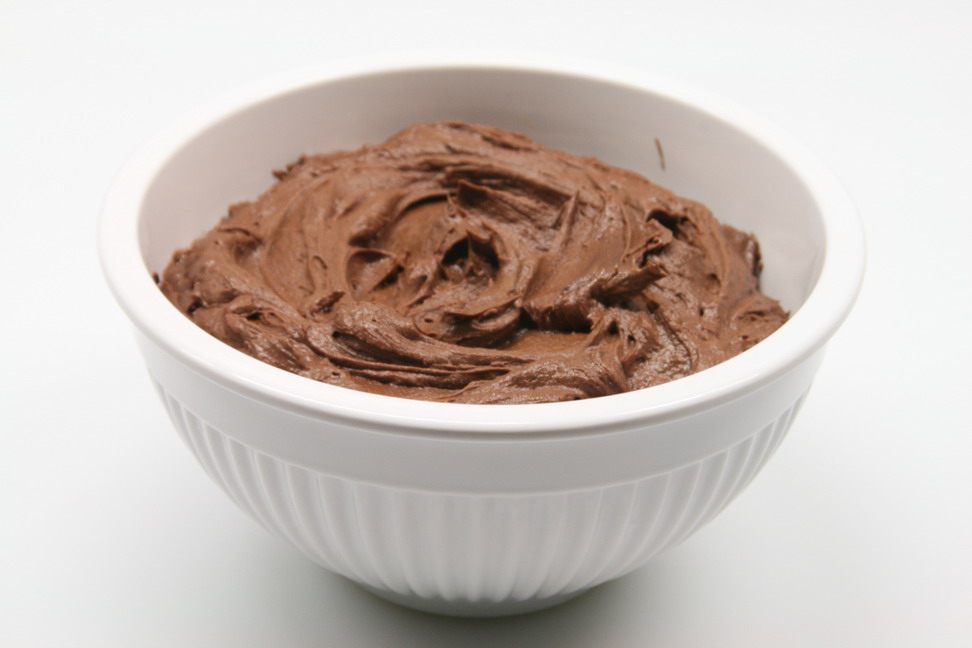 Frosting directions - Combine the cocoa powder, butter, sugar and vanilla. Slowly add in the milk 1 tbs. at a time. You may want to add in more milk depending on how thick you like your frosting. Beat frosting on high for 2-3 minutes with a hand mixer or your Kitchenaid. Once the brownies have cooled completely, lift the foil out of the pan (love the super easy clean-up!) Evenly spread the chocolate frosting over the top of the brownies. Cut into 12 squares. Break the rest of your Kit Kat bars into thirds and gently press one into the top of each brownie. Store in an airtight container up to 1 week.