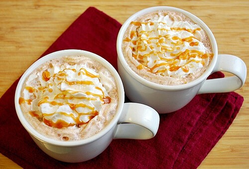 Put your hot chocolate into your caramel coated mug and add squirty cream to the top