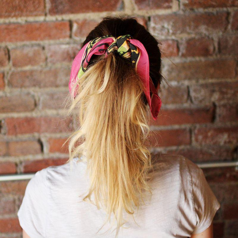 Style your hair into a pony tail. Tie the scarf over your hair tie so that it looks like a floppy bow!