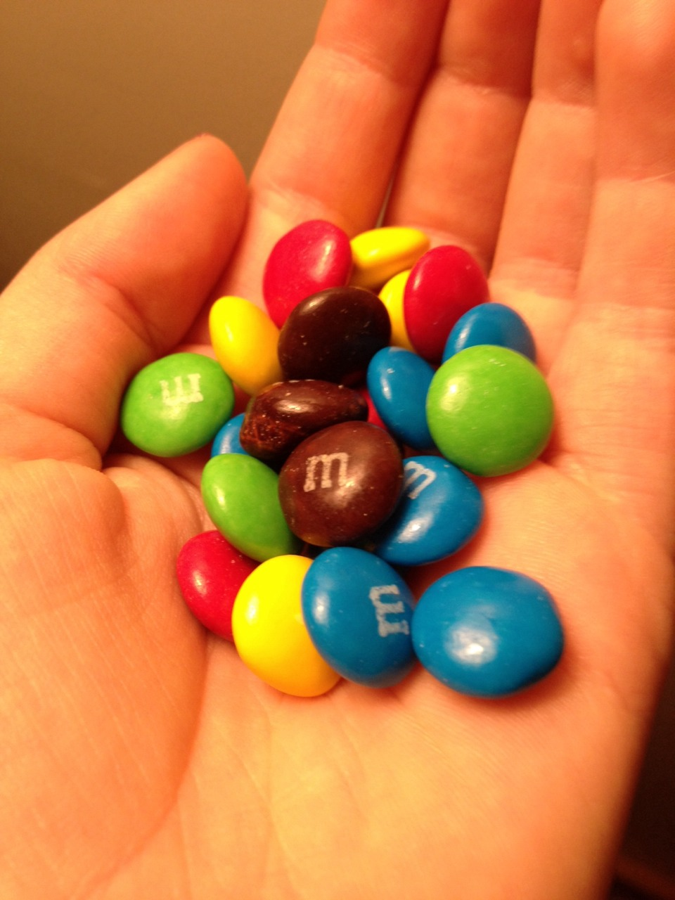 Buy some m&ms and put them in a bowl. Put them in the microwave for 45 seconds. The inside melts but the outside doesn't. Enjoy!