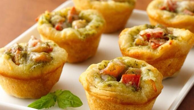 DIRECTIONS Heat oven to 375°F. Spray 20 mini muffin cups with cooking spray. In medium bowl, mix pesto, tomato and mozzarella cheese. Separate dough into 10 biscuits. Separate each biscuit into 2 rounds. Press 1 round in bottom and up side of each mini muffin cup.