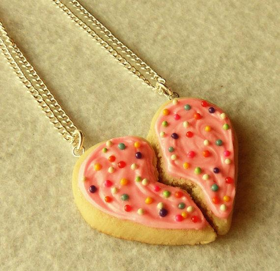 A cookie-shaped pendant.  https://www.etsy.com/listing/94756456/best-friends-sugar-cookie-half-heart