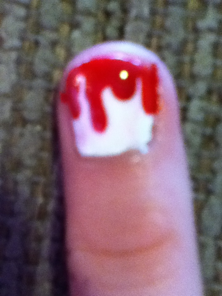 Paint your nails a base coat of white.  Take a bobby pin, dip it in red nail polish and starting from the top, pull it down.