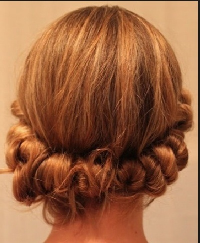 This is how your hair should look while the curls set if you use a headband. There is a video to help explain this one!