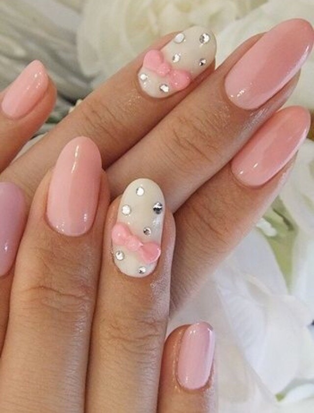 4. PASTEL PINK AND WHITE NAILS WITH RHINESTONES AND A FEMININE BOW
