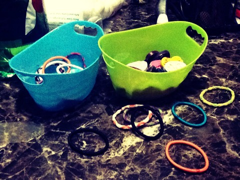 Use containers to put hair ties , crayons , jewelry , and makeup quickly