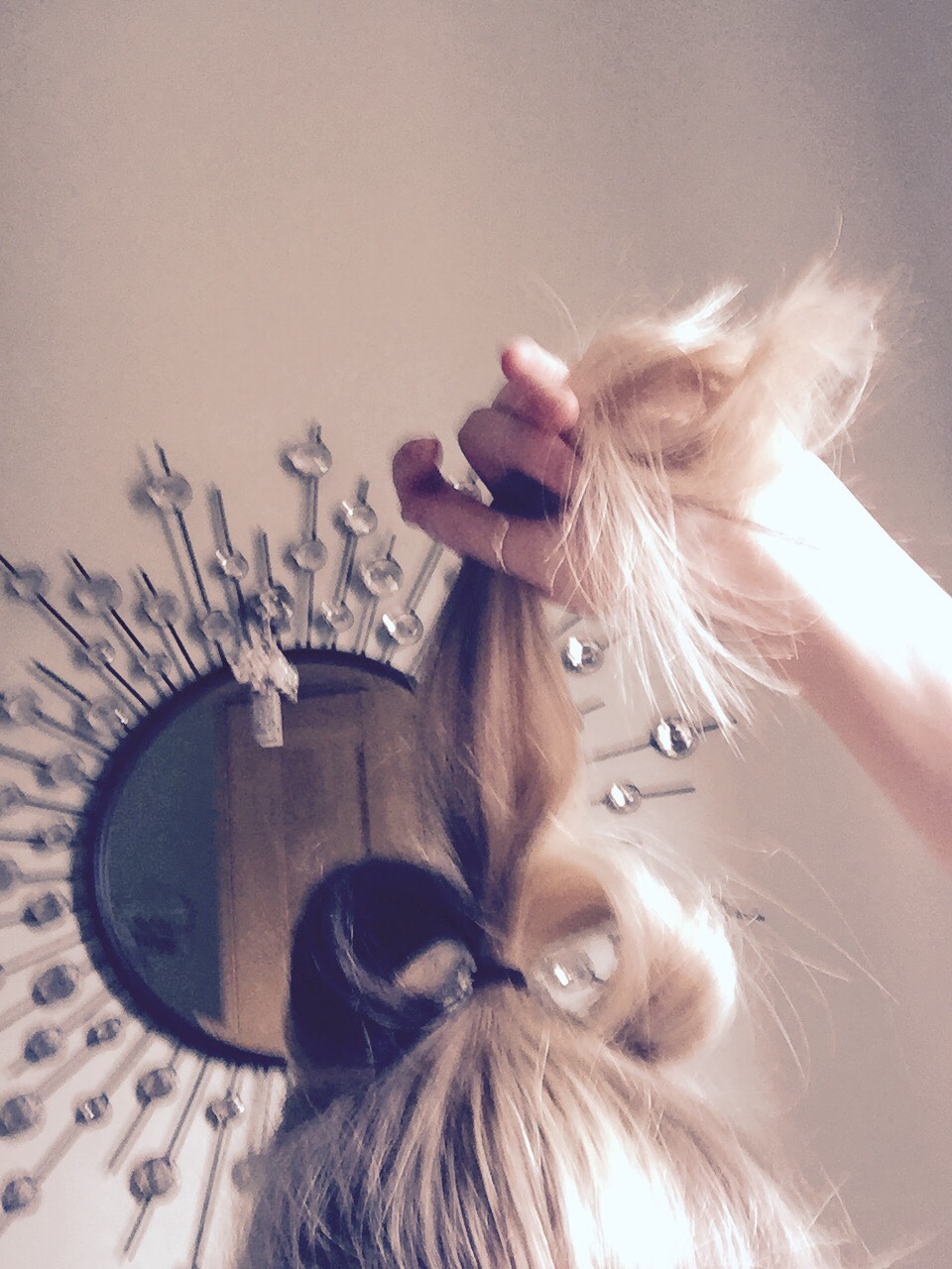 Split your ponytail in three.  Back brush and bend over and clip down with a bobby pin.