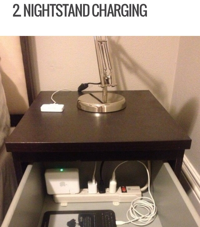 If you have a nightstand with a pullout drawer on the top, cut a hole in the back of the drawer to allow a power strip cord. Then you can plug in any devices you want to the power strip in your drawer while keeping them all tucked away safely. No more having your phone or tablet on the floor!