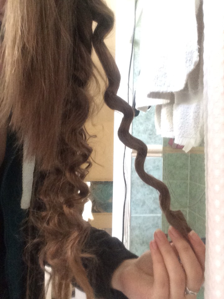 When you have finished putting the hair straighteners over the hair you would like to curl pull the pencil out. It should look like the picture above.