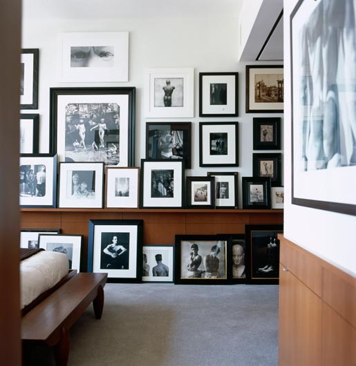 """7. A Counter That's Covered with Photos The whole """"piano top full of Christmas cards and holiday photos"""" should be seasonal at best. If you want to display some family photos, try a gallery wall of frames with different sized photographs (like this one shown here). It's baroque and hip."""
