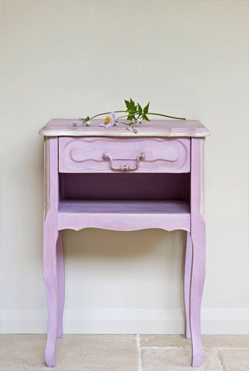 When re-opening your chalk paint, hold your container on an angle.  The dried chalk paint on the lid and container rim tends to crumble and fall into the fresh paint.