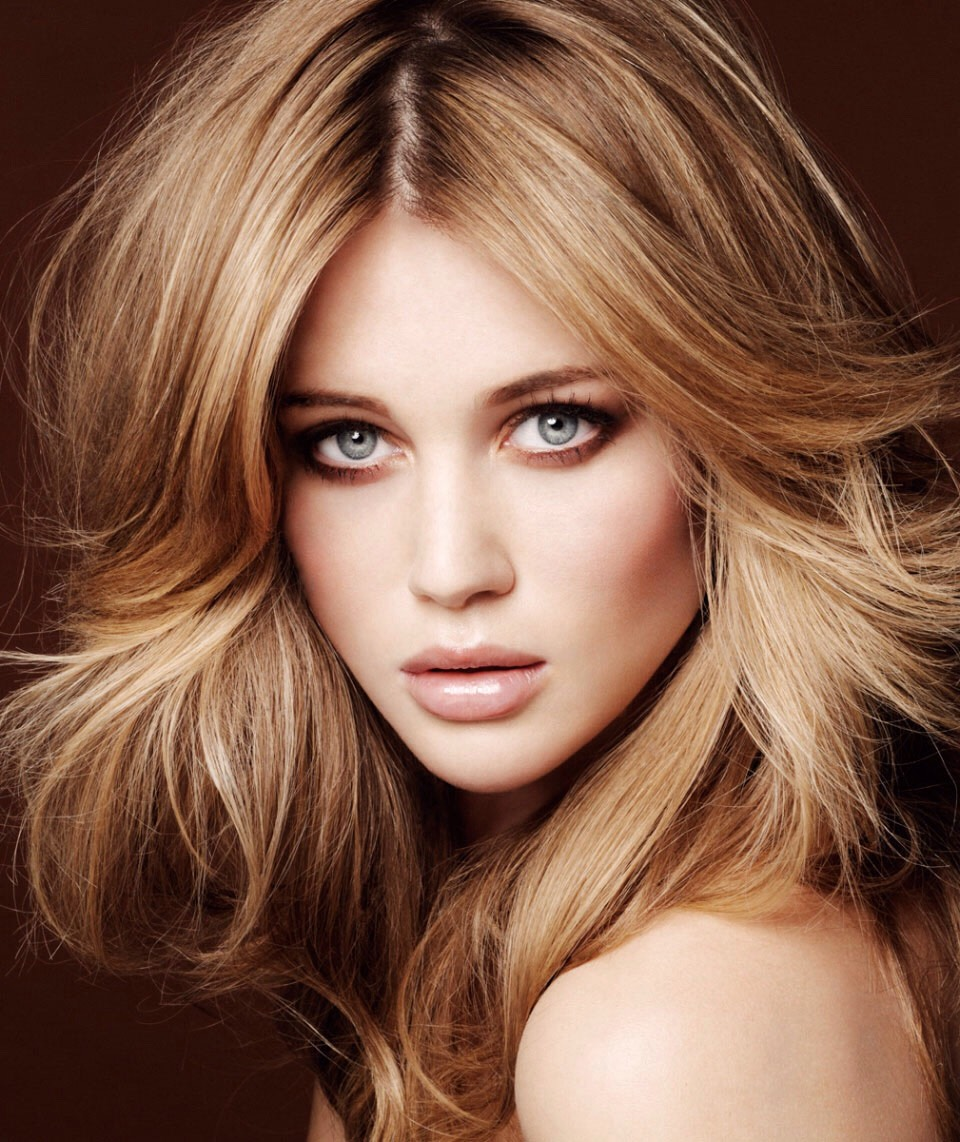 While teasing your hair, spray the section of hair with hairspray before you tease it for long lasting volume.