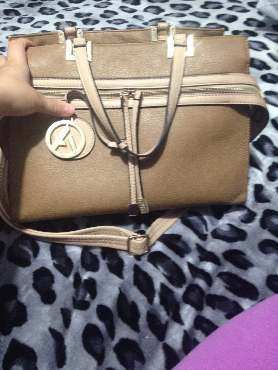 This is my favorite one..! It in the color brown with some vanilla color . Has a long strap also and its really nice can go with any outfit . It natrual .