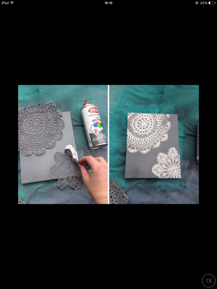A painted canvas and a doily is all it takes to make this beautiful piece of art work