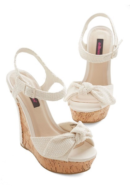 """A Pair Of Wedges A spring staple. Wood or straw, these are a go-to for college ladies' night out in the spring."""" Wedges are great because they can be dressed up or down, depending on the occasion. Bonus, they're a lot comfier to walk in than heels but will still give you a little extra height."""