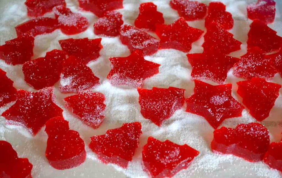 Sprinkle sugar over a piece of waxed paper and place gumdrops on top of sugar.  Let dry for about 8 hours or until slightly sticky.