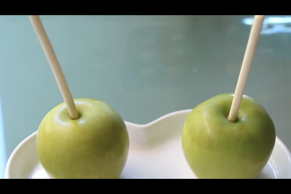 Place wooden stick halfway into apple