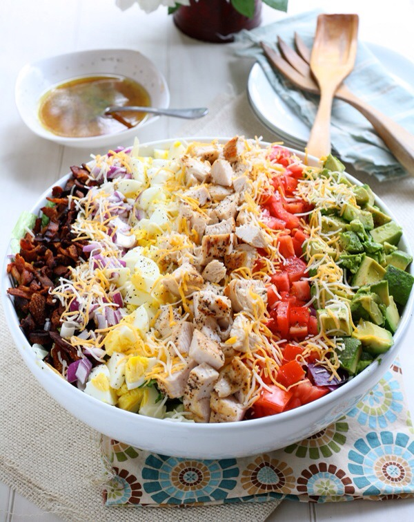 Classic Cobb Salad with Red Wine Lemon VinaigretteThis salad has everything but the kitchen sink, and promises to satisfy any craving you have! Not to mention it's stunning — the perfect dish to bring for your next summer potluck.