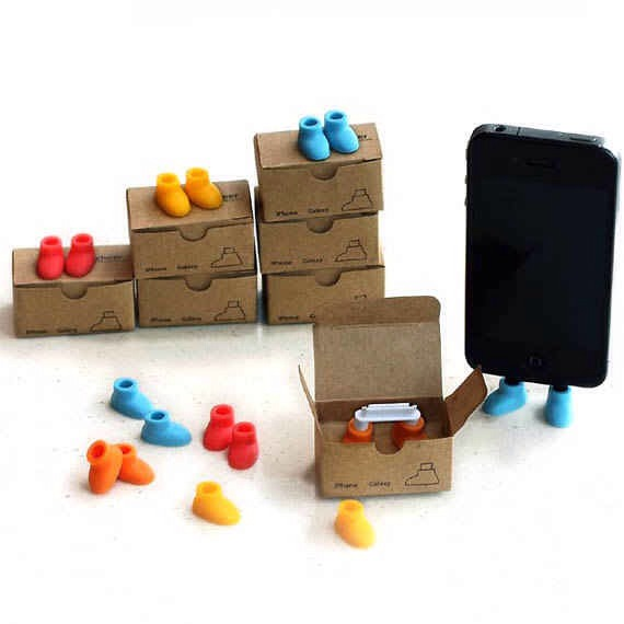 2. The Cutest Little iPhone Stand Ever, $5  Because who doesn't want to anthropomorphize their gadgets? Get it at etsy!