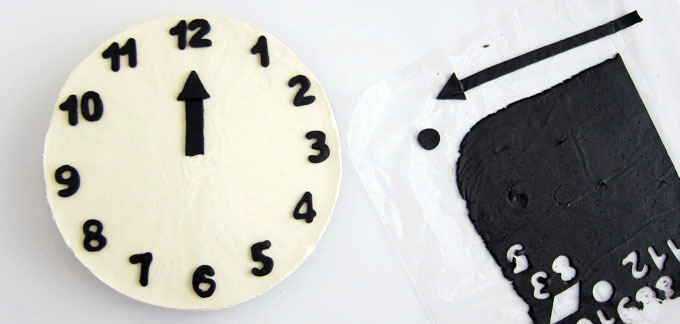Carefully peel chocolate numbers from zip top bag and place them on the cheesecake to form a clock. Add the chocolate clock hands so they show a few minutes before twelve o'clock. Keep refrigerated until ready to serve, up to four days.