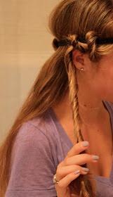 Now start tucking the hair around the headband like this.