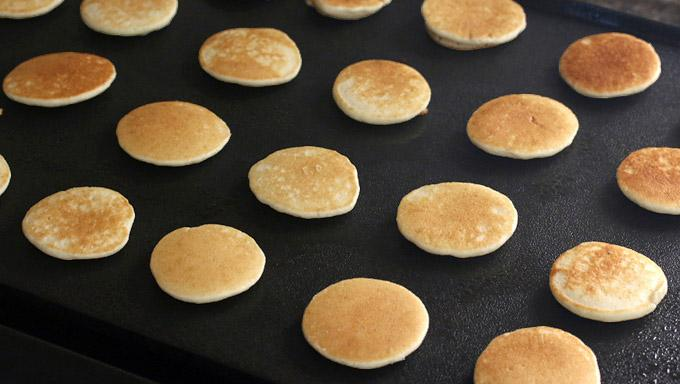 Cook the mini pancakes for about a minute on each side or until lightly browned.