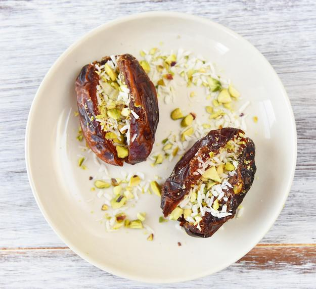 1. Coconut and Pistachio-Stuffed Dates  Just slice a couple dates lengthwise, take out the pits, and sprinkle in some finely chopped pistachios and shredded coconut.