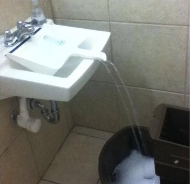 Use a clean dust pan to full a container that can't fit in the sink
