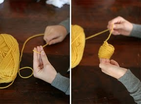 To start, hold the end of the yarn in your hand, and begin wrapping the yarn around your fingers – snug but not too tight. We recommend wrapping the yarn 90 times.