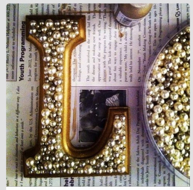 Wooden letters painted gold with pearls glued on. So cute!