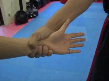 pull your arm toward where their thumb and fingers meet (the weakest point of their grip) via- (buzzfeed.com)