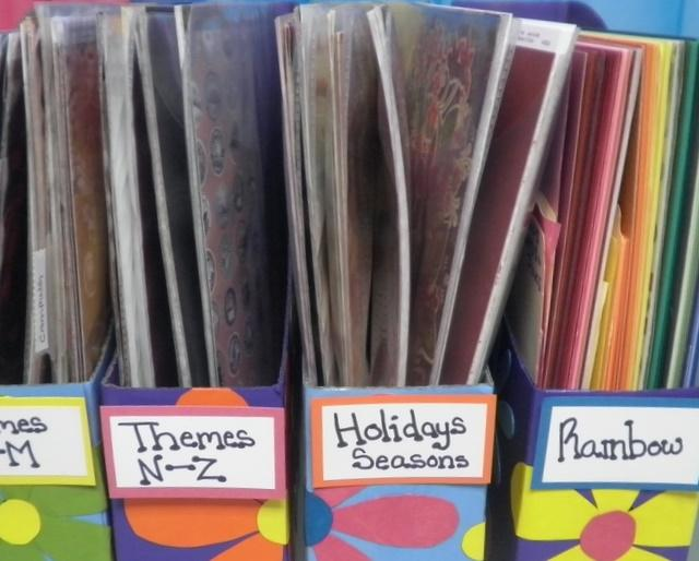 """create a list of Themes you scrap/craft about.Put your Paper Storage Boxes together. Simply follow the instructions on the bottom of the box. Use """"Sticky Notes"""" to label each. Begin sorting.  Sort in SMALL batches /2 or 4 inch stack of paper/"""