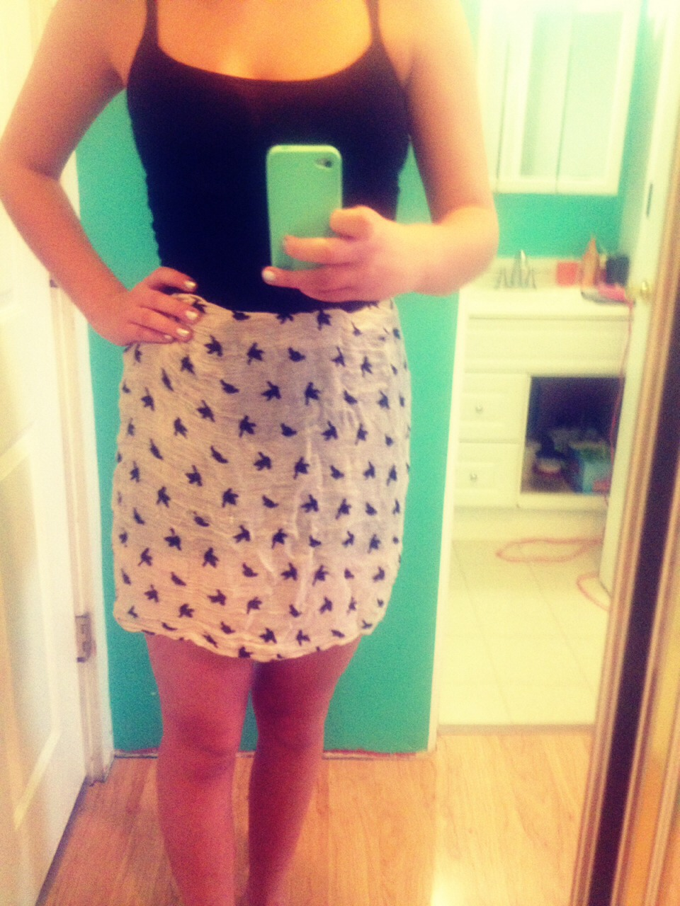 Tuck the top of the scarf over the belt and voila! You have a trendy skirt :)