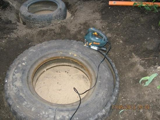 Using a power saw, cut the facing rim off the tire