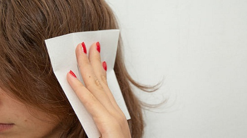 use dryer sheets to reduce frizz