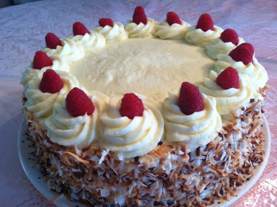 Vanilla Cake, Raspberry Filling, White Chocolate Buttercream, Toasted Coconut