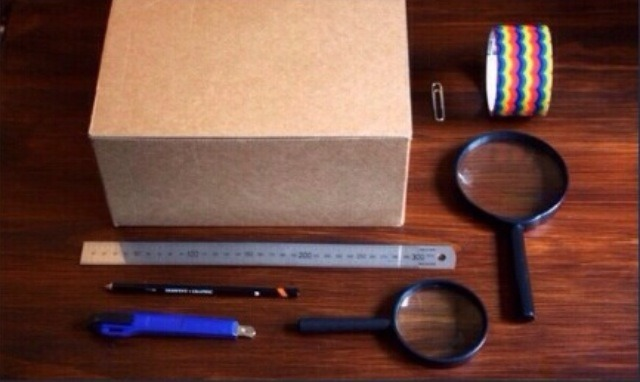 You will need: small box- magnifying glass-paper clip- smart phone-Stanley knife- duct tape- black paint (optional)