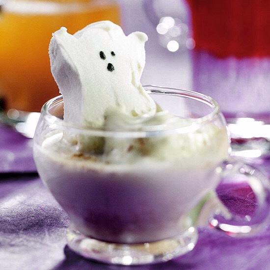 Haunting Hot Chocolate This hot white chocolate drink looks even spookier with a ghost-shape marshmallow floating in it. Warm up your guests -- and frighten them a bit too -- with this hot Halloween concoction.