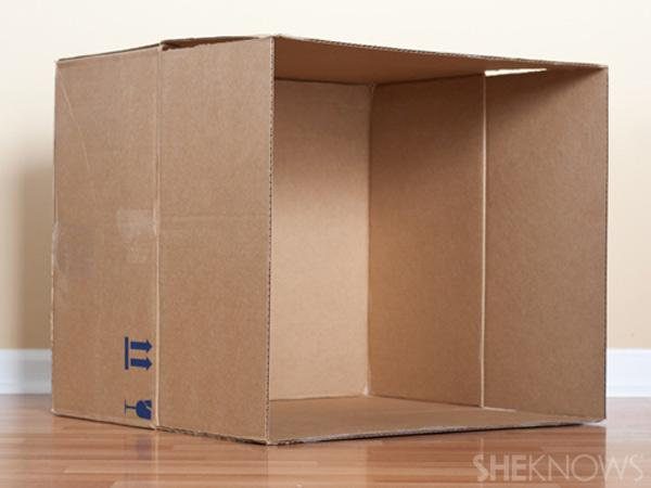 2. Position cardboard box Turn box on side so the opening is perpedicular to the floor.